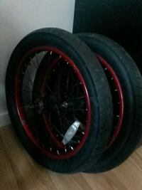 pair of black and bike rims with tires