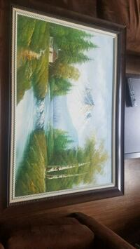 brown wooden framed painting of river College Park