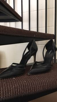 pair of black leather peep-toe heeled shoes null
