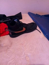 pair of black Nike running shoes Horizon City, 79928