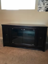 Wooden tv stand with glass doors 56x24x31 Winnipeg, R2V 4Y3