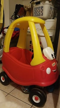 red and yellow ride-on plastic toy