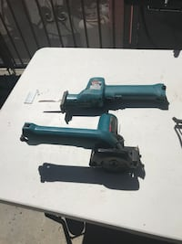 two assorted teal power tools