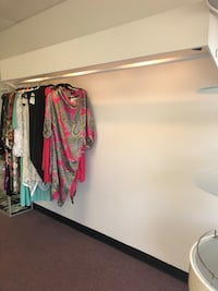 3 clothing racks with built in led lights