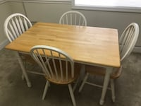"Rectangular brown wooden table with four windsor chairs. 48""x30""x29 1/2"" Fairfax, 22030"