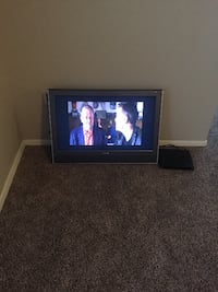 black flat screen TV with remote MESA