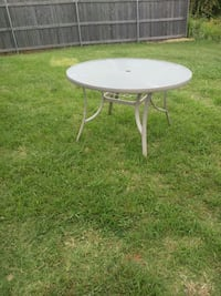 round white metal framed glass top patio table Oklahoma City, 73132