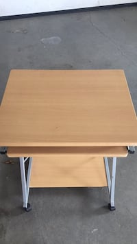 Brown wooden folding table with gray metal base Regina, S4R 5Y3
