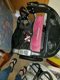 Pink and black stroller.. needs air in tires 35 km