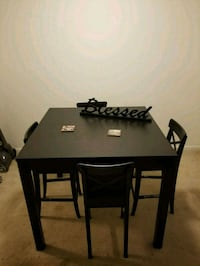 IKEA rectangular black wooden table w/ four chairs 34 mi