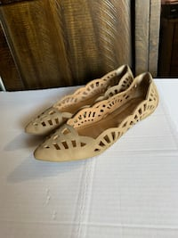 pair of brown leather wedge shoes