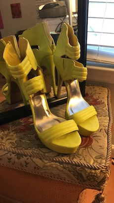 pair of yellow leather sling back stiletto sandals