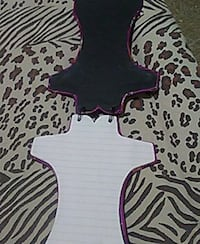 two black and white note pads