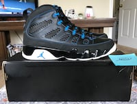 pair of black-and-blue Air Jordan basketball shoes with box