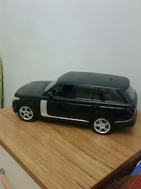 Black and silver sports utility vehicle toy car