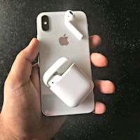 silver iPhone X and AirPods with charging case 1954 mi