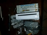 white Nintendo Wii console with controller and game cases Riverside, 92503