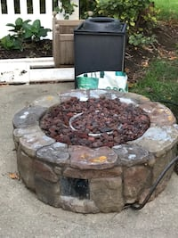 Gas fire pit- perfect for fun fall fires. Faux rock Hudson, 44236