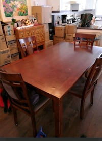 rectangular brown wooden table with chairs dining set Laval, H7H 2Z5
