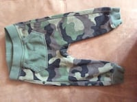 toddler's green, brown, beige, and black camouflage pants