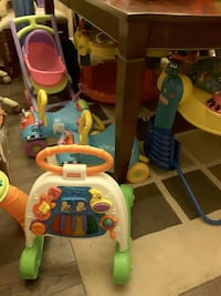 white green and orange fisher price learning walker