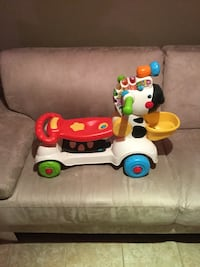 baby's red, white and blue fisher price ride on toy car Rocky View No. 44, T4B