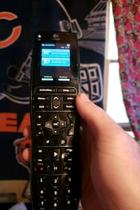 Remote control Logitech touch screen remote brand new all the software