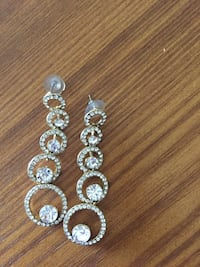 pair of silver diamond studded dongle earrings