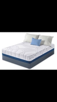 white and blue bed mattress