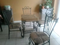 4x4glass top iron table with 4 iron chairs Dundalk, N0C 1B0