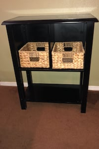 Small black shelf with baskets
