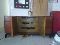 brown wooden single pedestal desk Madera