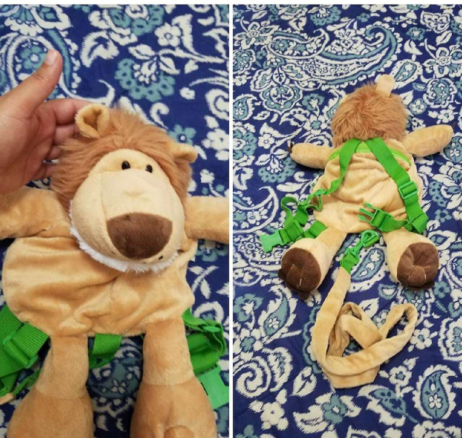 toddler's brown and green lion plush toy backpack