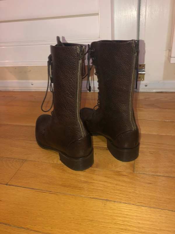 Pair of brown leather boots  c9853932-4886-44ab-9a70-6826c29a84aa