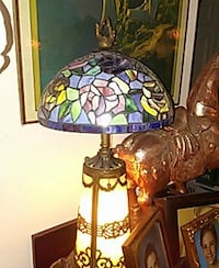 brown metal framed beige table lamp with blue and