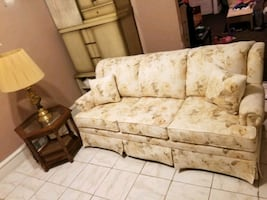 Very nice La-z-boy sofa bed, end table and lamp.