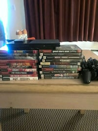 Ps2 slim with 20 games 2 controllers