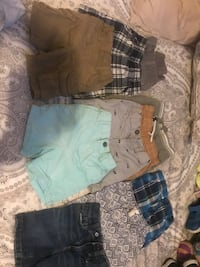 Two blue and one gray denim shorts