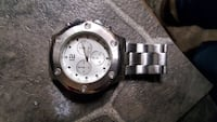 round silver chronograph watch with silver link bracelet