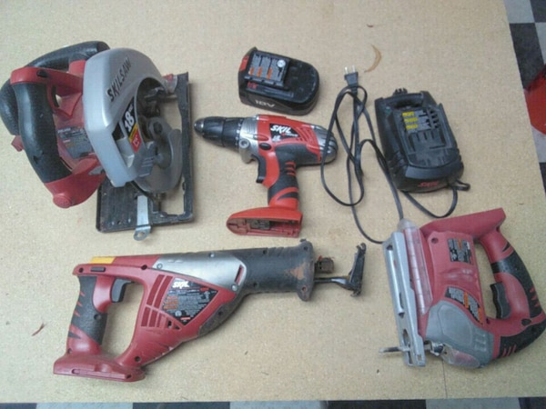 red and black Milwaukee power tools