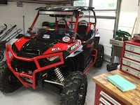 red and black DNL 500 UTV