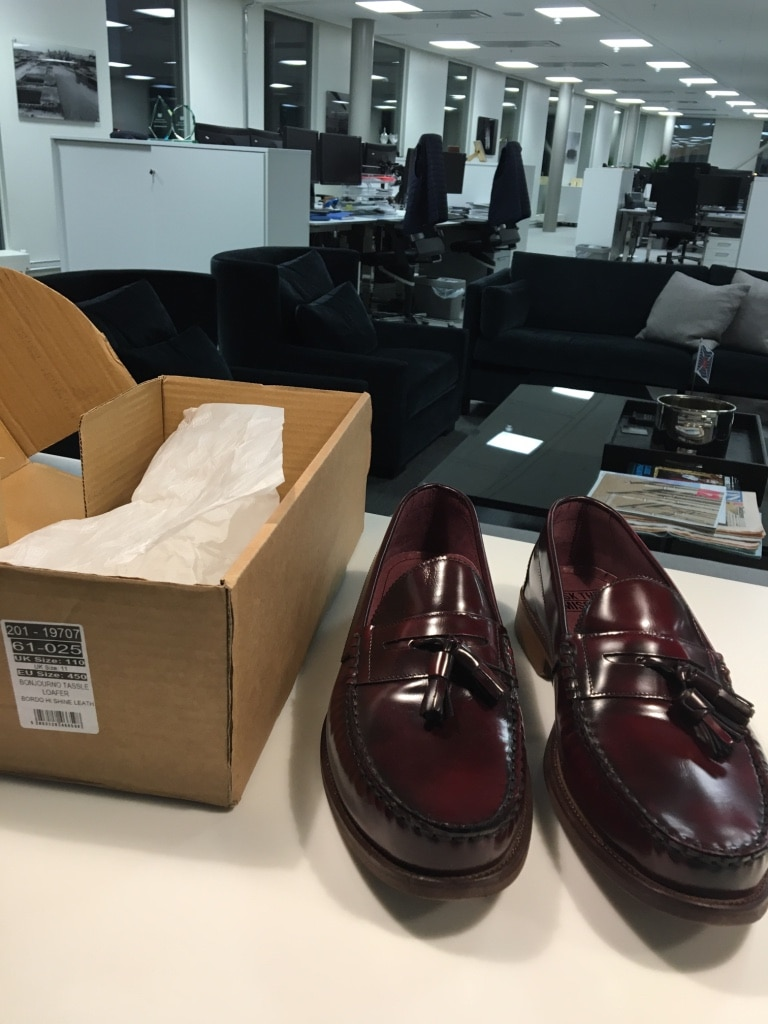 1 pair of black leather tassel loafers