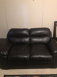 Black leather 2-seat sofa 2668 km