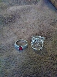 two silver and diamond rings