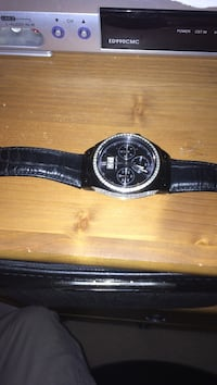 round black analog watch with black leather strap Whitby, L1M 2E5