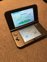 black Nintendo DS with game cartridge New York, 10029