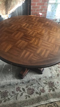round brown wooden pedestal table Pikesville, 21208