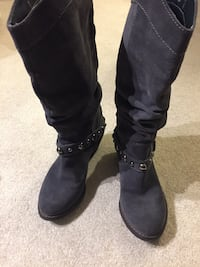 pair of grey suede boots