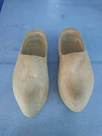 pair of brown wooden clogs New York