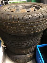 Four black automotive tires set
